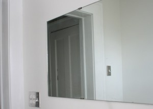 Frameless mirror on clips